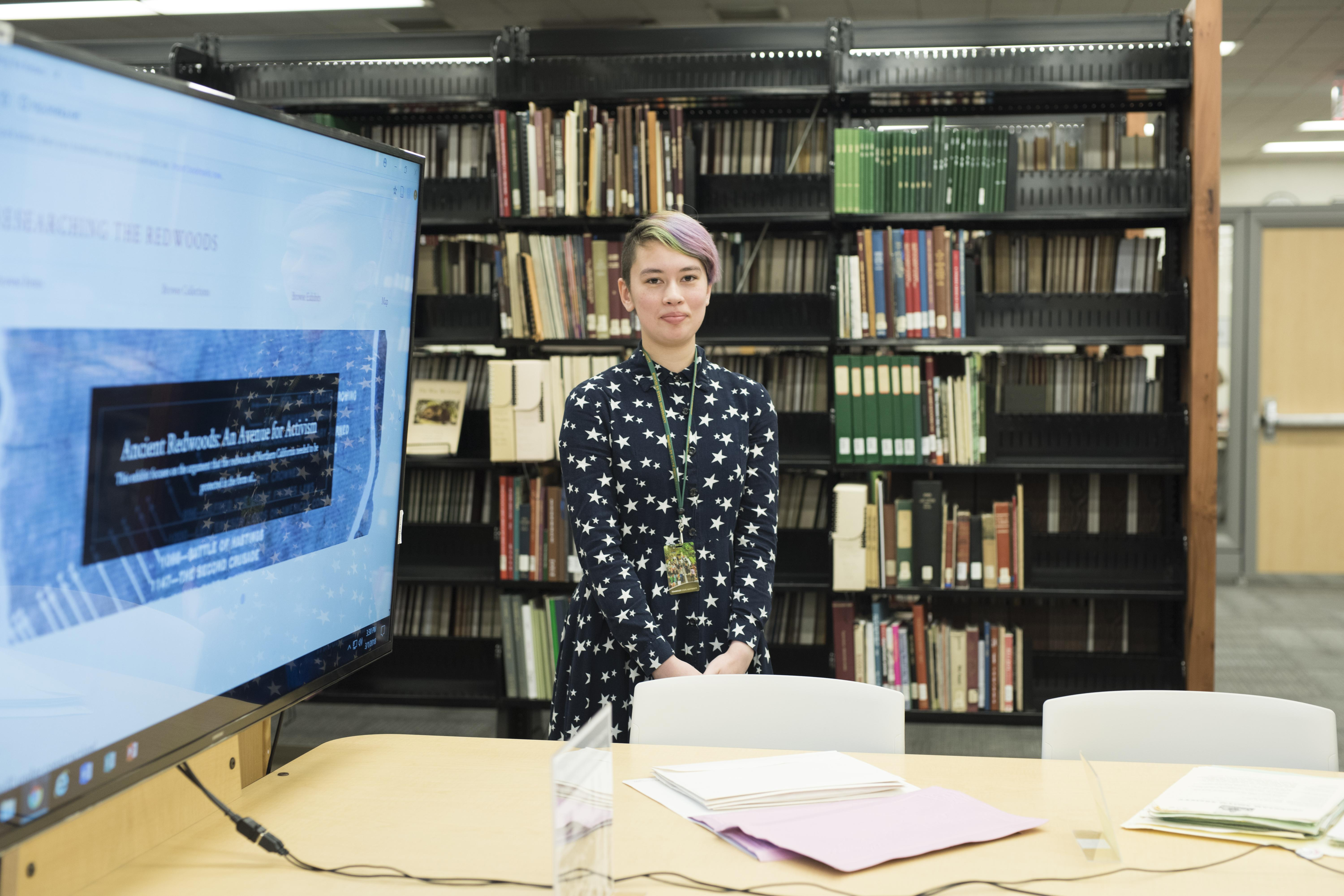 A Special Collections intern presents a project to a library open house