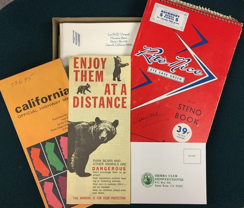 """Pamphlets and papers, one with a bear that says """"enjoy them at a distance, one is a California highway map, one is a Sierra club postcard and one is a """"Rite Nice"""" red notebook"""