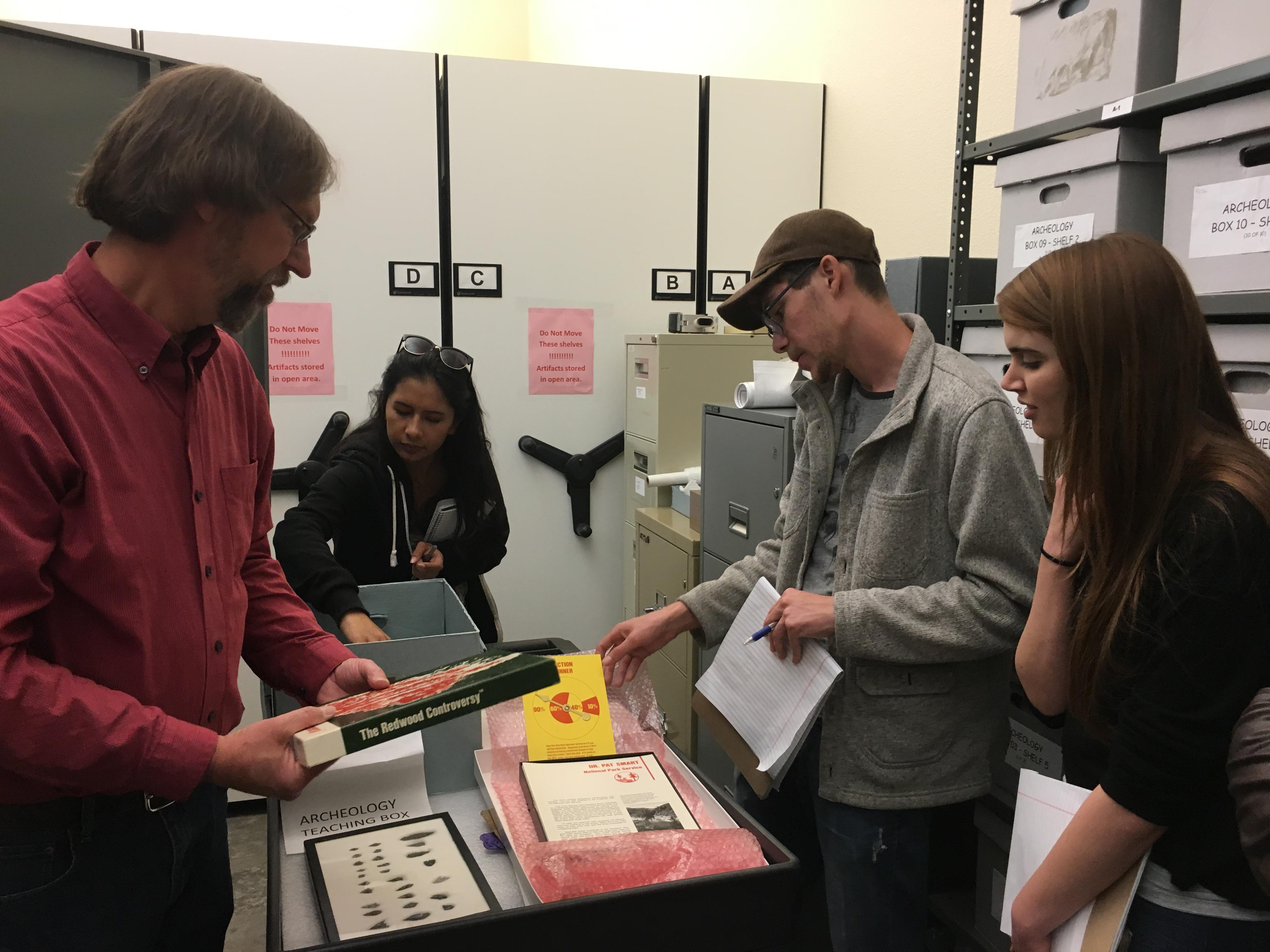 Special Collections Interns view the Redwood National Park Collection